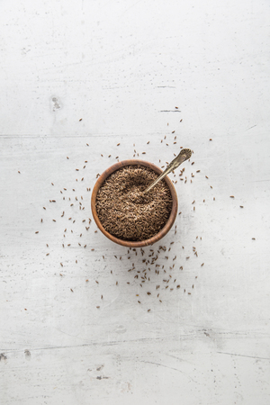 Cumin. Top of view full bowl of  cumin. Stock Photo