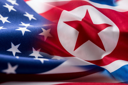 American and north korea flag. Colorful USA and North Korea flag waving in the wind. Stock Photo
