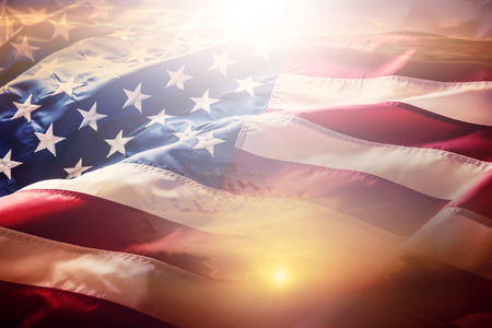 USA flag. American flag. American flag blowing wind at sunset or sunrise. Close-up.  스톡 콘텐츠