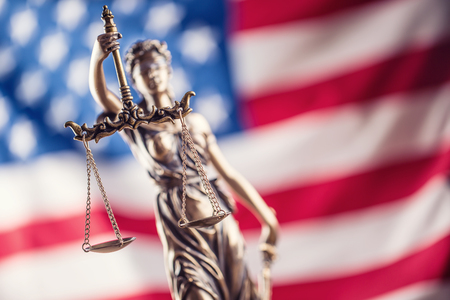 Lady Justice and American flag. Symbol of law and justice with USA Flag. Standard-Bild - 97438964