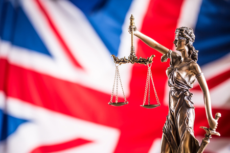 Lady Justice and United Kingdom flag. Symbol of law and justice with UK Flag. Brexit.