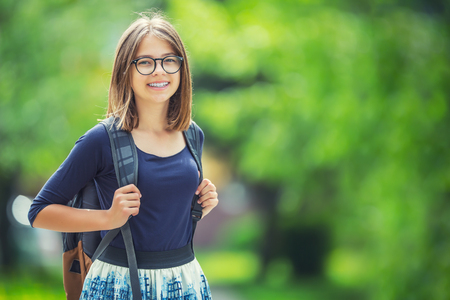 Portrait of attractive young teenage school girl with backpack.