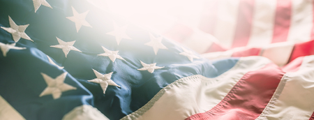 Close-up banner of american flag stars and stripes.