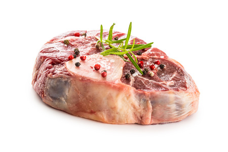 Raw beef shank with salt pepper and rosemary isolated on white background. Archivio Fotografico