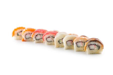 Portion of sushi uramaki isolated on white background. Stock Photo