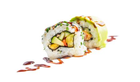 Sushi uramaki with soy sauce isolated on white background. Stock Photo - 103845687