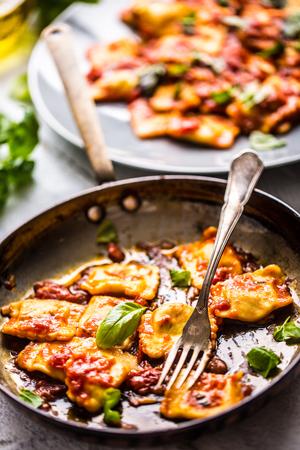Italian or mediterranean food pasta ravioli of tomato sauce and basil. Archivio Fotografico