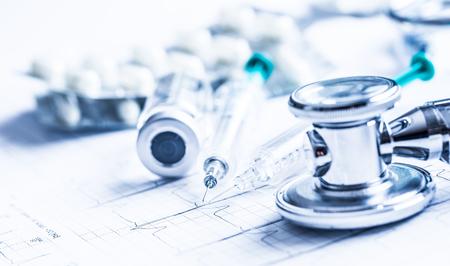 Stethoscope injections pills on the  EKG graph -  elektrokardiogram. Stock Photo