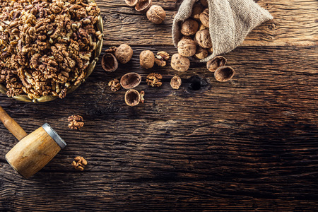 Walnut kernels whole walnuts in burlap sack and vintage bowl.