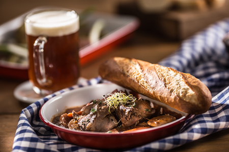 Roast wild boar with carrot mushrooms, baguette and draft beer.