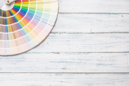 Top of view color palette on wooden table.