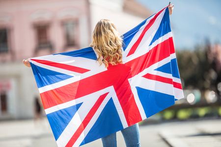 Attractive happy young girl with the flag of the Great Britain. Reklamní fotografie