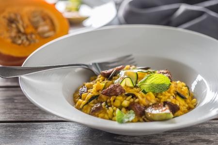 Pumpkin risotto figs zucchini and min leaves. italian or mediterranean cuisine. Stock Photo