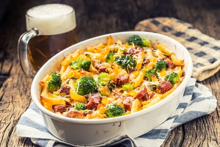 Baked pasta penne with broccoli smoked pork neck mozzarela cheese and othe ingredients.