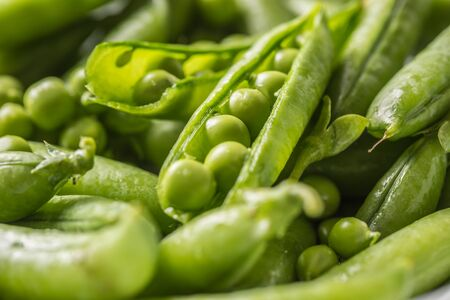 Fresh green pea seeds and pods - Close up. Stock Photo