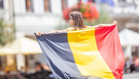 Attractive happy young girl with the Belgian flag. 免版税图像