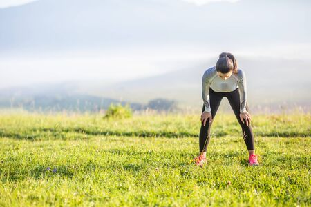 Young woman athlete runner tired breathing after running. 写真素材