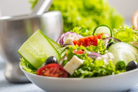 Salad with fresh vegetables olives tomatoes red onion greek cheese feta and olive oil. Stok Fotoğraf
