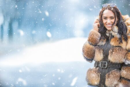 Winter portrait of attractive young woman in warm clothing from polar fox. 版權商用圖片