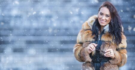 Winter portrait of attractive young woman in warm clothing from polar fox. Zdjęcie Seryjne
