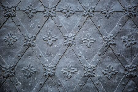 Rustic ancient doors pattern medieval repetitive ornaments.