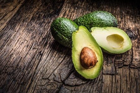 Fresh avocado on rustic wooden table - Close up.