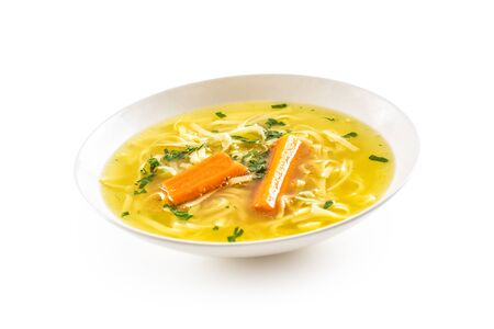 Chicken duck turkey or beef soup with homemade noodles carrot and celery herbs in white plate isolated on white.