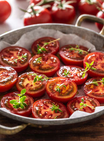Fresh tomatoes in pan ready to dry or roasted.