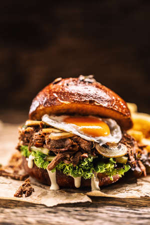 Burger stuffed with shredded confit turkey egg mushrooms and french fries. Banco de Imagens