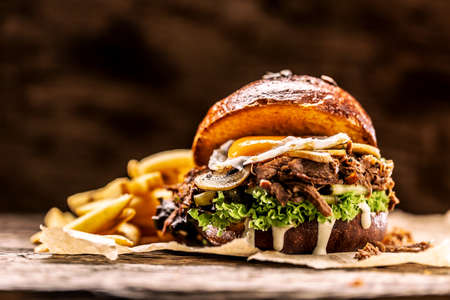 Burger stuffed with shredded confit turkey egg mushrooms and french fries.