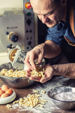 Freshly made twisted shape Italian pasta in the hands of a small producer.