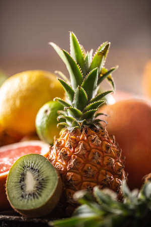 Exotic fruit such as pineapple, kiwi and citruses in a detail.
