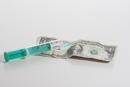 Syringe and money on white background Stock Photo - 15502418