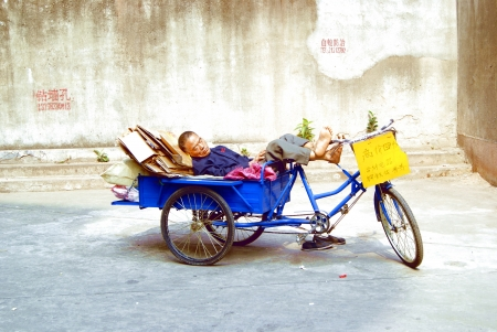 The sleeping man in tricycle