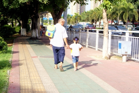 come home: Grandfather with the grandson, come home from school