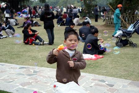 blowing bubbles: Closeup a boy blowing bubbles Editorial