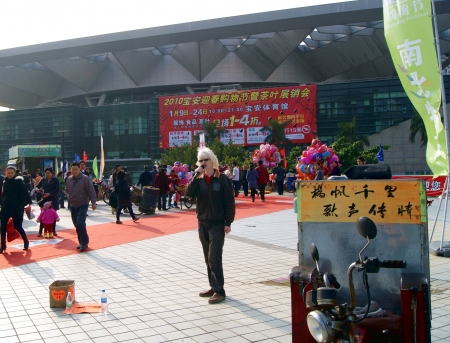 exhibition crowd: People standing outside of exhibition hall Editorial