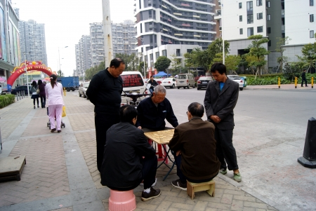 playing chess: People playing chess beside of the street Editorial