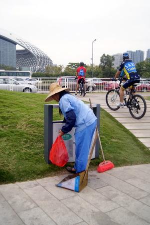 picking: Cleaner picking up rubbish