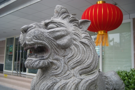 Stone lions and red lanterns photo