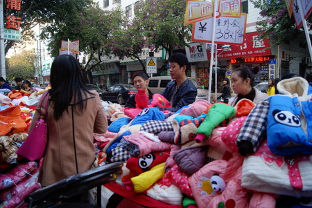 people buying: People buying the clothes on the street Editorial