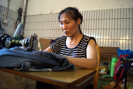 mending: Woman is mending clothes