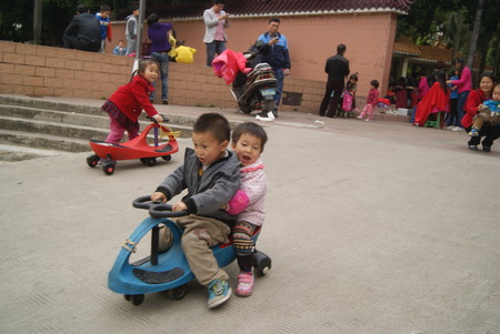 children play: The children play outdoors, in China Editorial