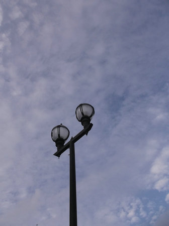 street lamps: Blue sky and white clouds and street lamps