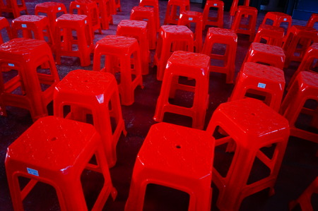 stool: Red plastic stool