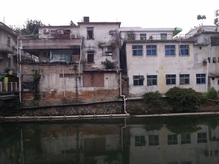 old  buildings: Old buildings in Shenzhen Xixiang River Stock Photo