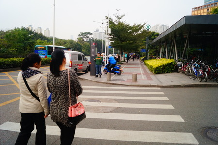 sidewalks: Tourists in tourist attractions, in Shenzhen, China Editorial
