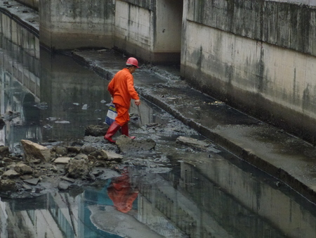 sanitation: Sanitation workers to clean up river garbage, in China Editorial
