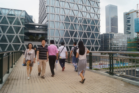 People walking on a city bridge Editorial