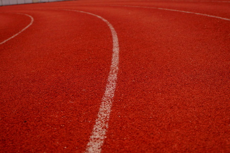 Red plastic track and field track